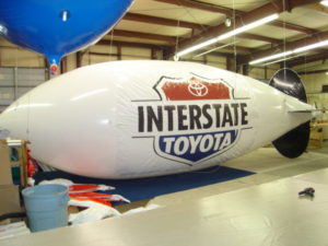 30 foot long advertising blimp for South Portland auto dealers