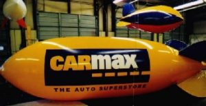 advertising blimp with CarMax logo for auto dealers in  width=